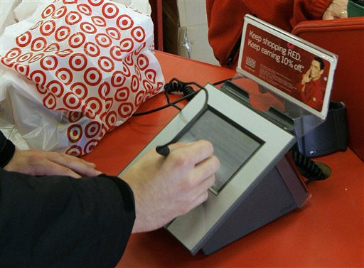 In this Jan. 18, 2008 file photo, a customer signs his credit card receipt at a Target store in Tallahassee, Fla. Target says that about 40 million credit and debit card accounts customers may have been affected by a data breach that occurred at its U.S. stores between Nov. 27, 2013, and Dec. 15, 2013. (AP Photo/Phil Coale, File)