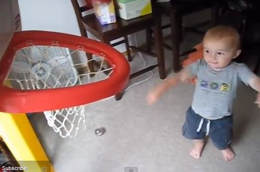 Titus Ashby, 2, makes a perfect shot barely looking. He repeats the feat from various angles and heights effortlessly. (Screenshot/YouTube)