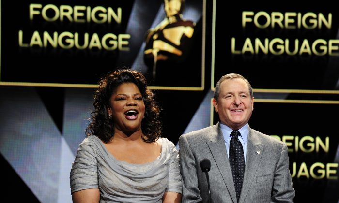 Tom Sherak and actress Mo'Nique read the nominees for Best Foreign Film at the 83rd Annual Academy Awards Nominations Announcement in this January 2011 file photo. (Robyn Beck/AFP/Getty Images)