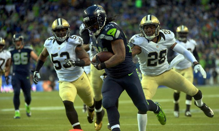 Running back Marshawn Lynch #24 of the Seattle Seahawks scores a 31-yard touchdown run against the New Orleans Saints in the fourth quarter during the NFC Divisional Playoff Game at CenturyLink Field on January 11, 2014 in Seattle, Washington. (Harry How/Getty Images)