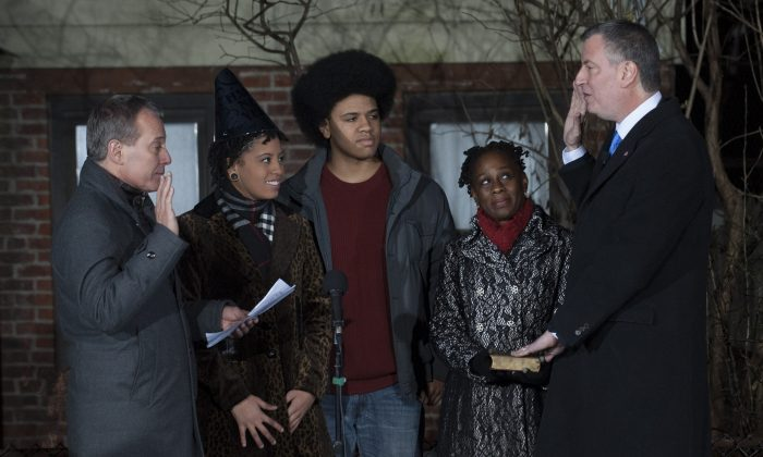 Bill de Blasio takes the oath of office from Attorney General Eric Schneiderman just after midnight on Jan. 1, 2014 in Park Slope Brooklyn. (photo courtesy the Mayor's Office)
