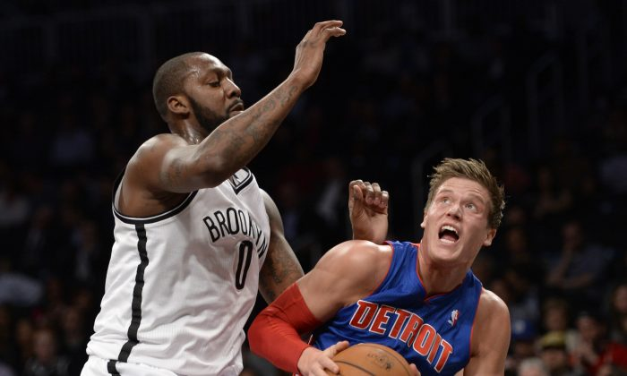 Andray Blatche guards Jonas Jerabko in an April 2013 file photo. Blatche could join The Philippines national team. (Timothy A. Clary/AFP/Getty Images)