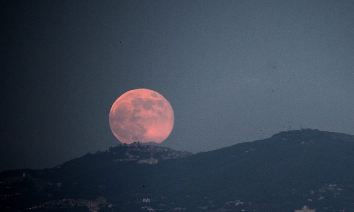 A supermoon in a June 2013 file photo rises over the city of Rome. (Filippo Monteforte/AFP/Getty Images)