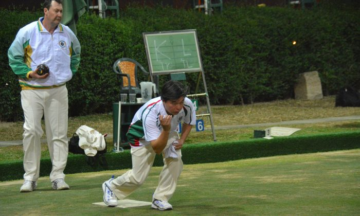 Timmy Kwong (delivering) of Kowloon Cricket Club on his way to winning the Final of the National Knock-out Singles. Kwong defeated New Zealander Dave Hanson 17:9 to win his first national title on Sunday Jan 5, 2014. (Stephanie Worth)