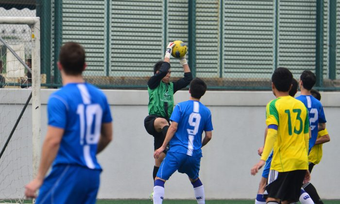 Lucky Miles' goalie, Paul Ting makes yet another important save in his team's HKFA Second Division match against Wanchai at Happy Valley on Sunday Jan 26. But Ting's efforts strengthen their position outside of the relegation zone were insufficient with Lucky Mile losing 2-1 to Wanchai. (Bill Cox/Epoch Times)