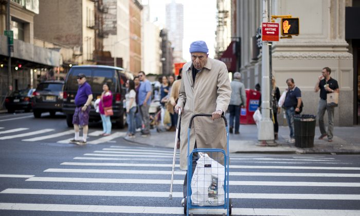 An elderly man crosses a street in Lower Manhattan on Sept. 19, 2013. Being struck by a car is the second-leading cause of injury-related death for senior citizens in the city. (Samira Bouaou/Epoch Times)