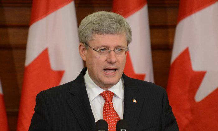 Prime Minister Stephen Harper's government faces some serious challenges in the year ahead, including an ongoing Senate scandal, unruly backbenchers, and a possible showdown with organized labour. (Matthew Little/Epoch Times)