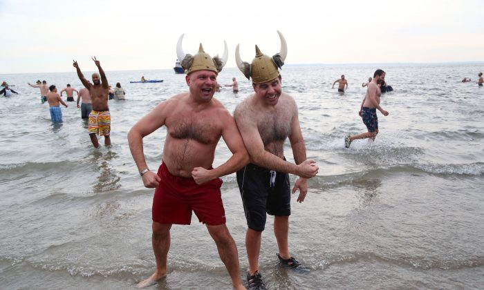 Participants of the New Year's Day Coney Island Polar Bear Plunge pose after a chilly plunge at Coney Island Beach, Brooklyn, New York, Jan. 1, 2014. (Christian Watjen/Epoch Times)