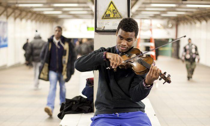 Jafari Sampson, a South Bronx native violin prodigy, plays inside Grand Central Terminal, New York, on Jan. 2, 2014. (Samira Bouaou/Epoch Times)