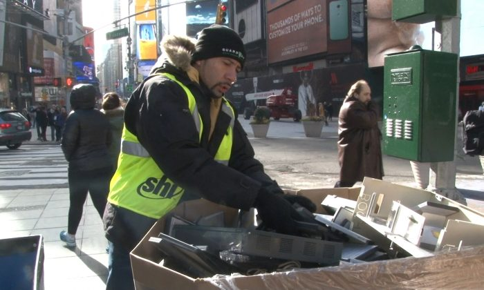 A SHI employee moves electronics to be recycled during an e-waste event in Times Square, New York, Jan. 8, 2014. (Seth Hirsch)