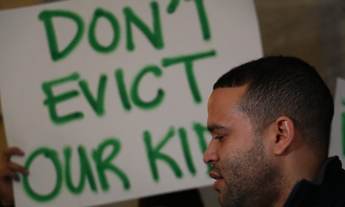 Rafael Lois at protest against lawsuits by Families for Excellent Schools at New York City Hall, Dec. 7, 2014. (Holly Kellum)