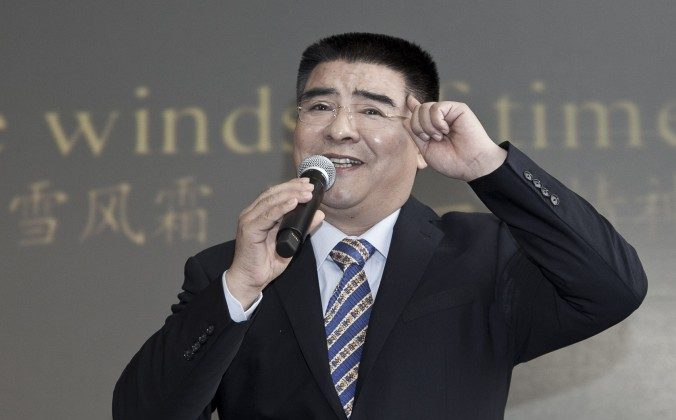 Chen Guangbiao sings karaoke at a press conference he called for the morning of Tuesday, Jan. 7, in a hotel in New York City. His eccentric presentation cloaked a serious purpose, reviving a propaganda hoax, argues R.J. Mitchell. (Samira Bouaou/Epoch Times)