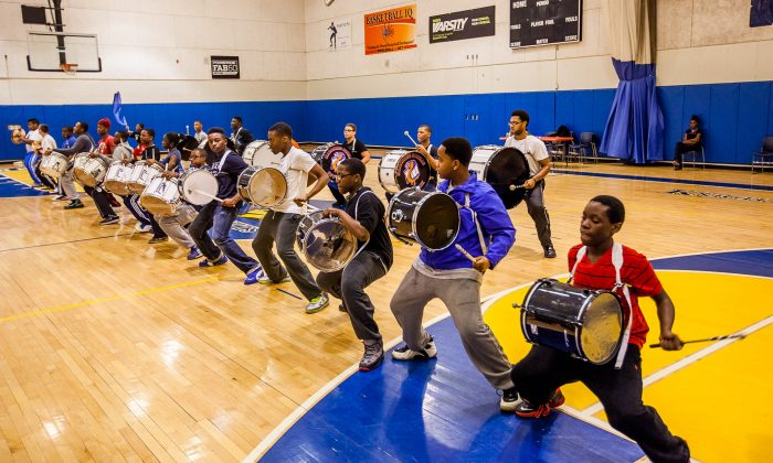 Members of the Marching Cobras band practice for their Super Bowl debut at the St. Christopher's Clark Academy in Dobbs Ferry, N.Y., Jan. 25, 2014. (Petr Svab/Epoch Times)