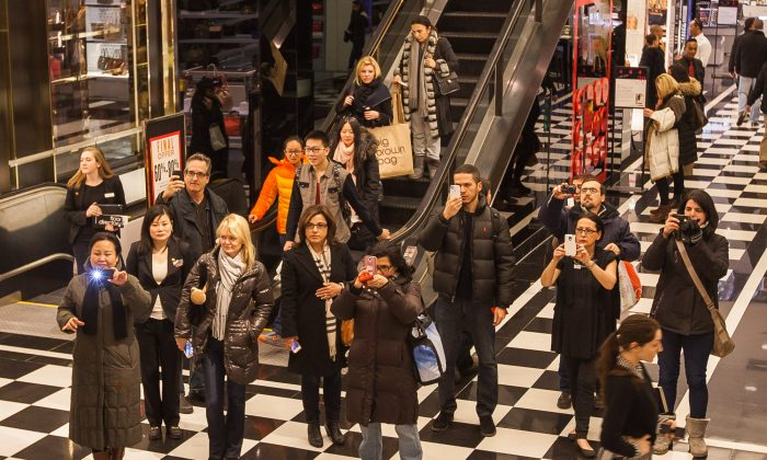 Shoppers take photos of Lunar New Year displays inside Bloomingdale's on 59th Street, Jan. 30, 2014. (Petr Svab/Epoch Times)