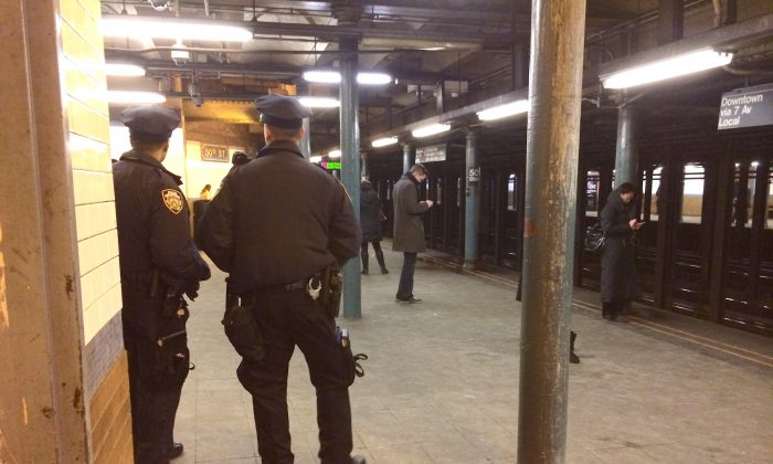 NYPD officers at the 50th St. subway station in Manhattan, New York, Jan. 29, 2014. An extra police police presence is monitoring subway stations in the week before Super Bowl XLVIII. (Matt Gnaizda)