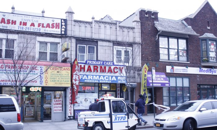 The building at 90-20 Sutphin Blvd. where Deisy Garcia, 21, and her two daughters were found stabbed to death in their apartment above a pharmacy, Queens, New York, Jan. 20, 2014. (Jane Gray/Epoch Times)