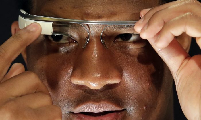 Florida State's Jameis Winston tries out some Google glasses during media day for the NCAA BCS National Championship college football game Saturday, Jan. 4, 2014, in Newport Beach, Calif. Florida State plays Auburn on Monday, Jan. 6, 2014. (AP Photo/Chris Carlson)
