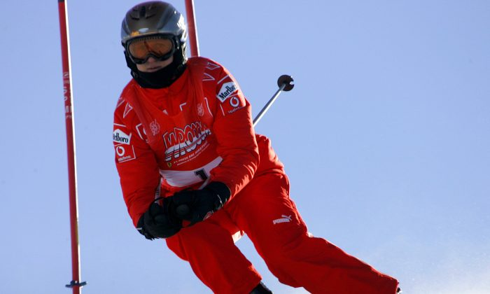 In this Friday, Jan. 13, 2006 file photo, Ferrari driver Michael Schumacher of Germany speeds down a course in Madonna di Campiglio, Italy. Schumacher is in this Italian Alps ski resort for the yearly meeting between Ferrari drivers and the press. (AP Photo/Luca Bruno, File)