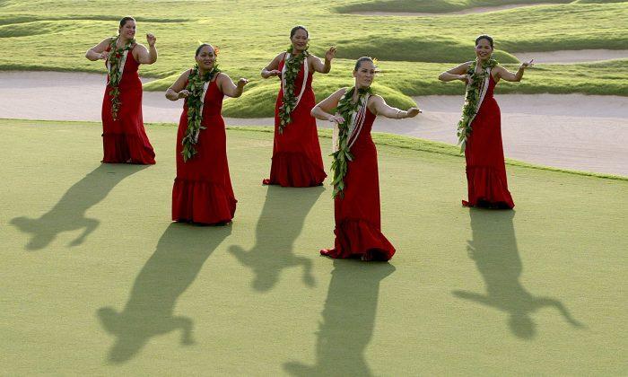 Hula dancers entertain the crowd in Ka'upulehu, Hawaii. (Photo by Jonathan Ferrey/Getty Images)