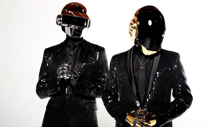In this April 17, 2013 file photo, Thomas Bangalter, left, and Guy-Manuel de Homem-Christo, from the music group, Daft Punk, pose for a portrait in Los Angeles. Daft Punk has won two awards in the 2014 Grammy Awards. (Matt Sayles/Invision/AP, File)