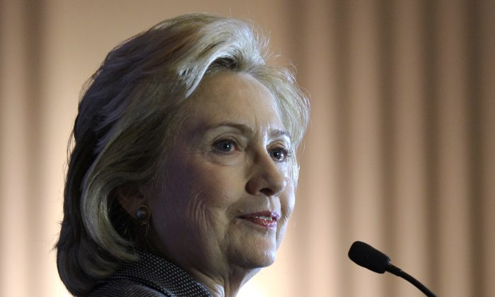 In this Dec. 6, 2013 file photo, former Secretary of State Hillary Rodham Clinton speaks on Capitol Hill in Washington. (AP Photo/Susan Walsh, File)