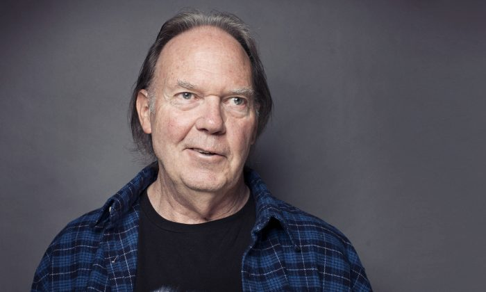 Singer-songwriter Neil Young posing for a portrait at The Carlyle hotel in New York in this file photo from 2012. (Victoria Will/Invision/AP, File)