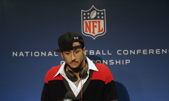San Francisco 49ers quarterback Colin Kaepernick speaks during a news conference after the NFL football NFC Championship game against the Seattle Seahawks, Sunday, Jan. 19, 2014, in Seattle. The Seahawks won 23-17 to advance to Super Bowl XLVIII. (AP Photo/Ted S. Warren)