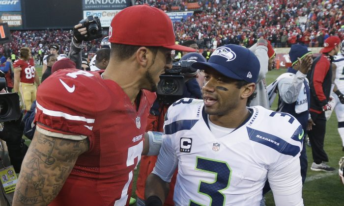In this Dec. 8, 2013, file photo, San Francisco 49ers quarterback Colin Kaepernick, left, talks with Seattle Seahawks quarterback Russell Wilson (3) after an NFL football game in San Francisco. The 49ers beat the Seahawks 19-17. The Seahawks host the 49ers in the NFC championship on Sunday.  (AP Photo/Marcio Jose Sanchez)