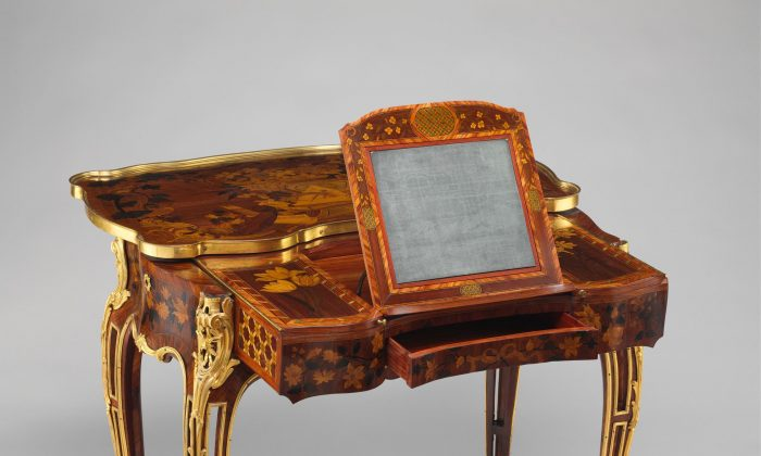 """Mechanical Table"" (ca. 1761–1763) crafted by Jean-François Oeben and Roger Vandercruse, called Lacroix. Oak veneered with mahogany, kingwood, and tulipwood. The marquetry of mahogany, rosewood, holly, and various other woods. Gilt-bronze mounts and imitation Japanese lacquer; replaced silk. (Courtesy of The Metropolitan Museum of Art, New York)"