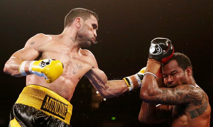 Anthony Mundine lands a left on Shane Mosley during the WBA International super welterweight title bout on November 27, 2013. (Mark Metcalfe/Getty Images)
