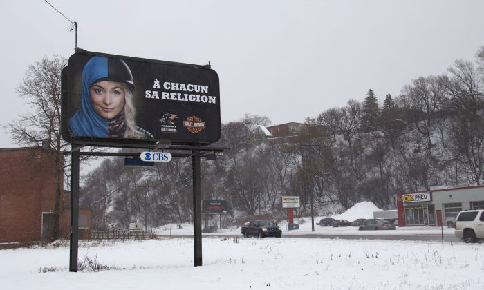 "A billboard in Quebec reading ""To each his own religion,"" shows the face of a woman wearing a hijab on one side and a motorcycle helmet and jacket on the other. The ad is part of a campaign by a Harley-Davidson motorcycle dealer opposing Québec's proposed values charter. A sovereignty group says the charter is a bad idea and will be detrimental to Muslim women. (Anne Levasseur/AFP/Getty Images)"