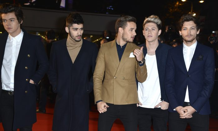 (L-R) Harry Styles, Zayn Malik, Liam Payne, Niall Horan and Louis Tomlinson of One Direction attend the 15th NRJ Music Awards at Palais des Festivals on December 14, 2013 in Cannes, France. (Pascal Le Segretain/Getty Images)