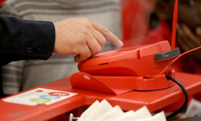 A customer uses a credit card terminal at a Target store in Miami, Fla., Dec. 13, 2013. Information from more than 40 million credit cards was stolen from the retail giant between November 27 and December 15 in one of the biggest data breaches in corporate history.