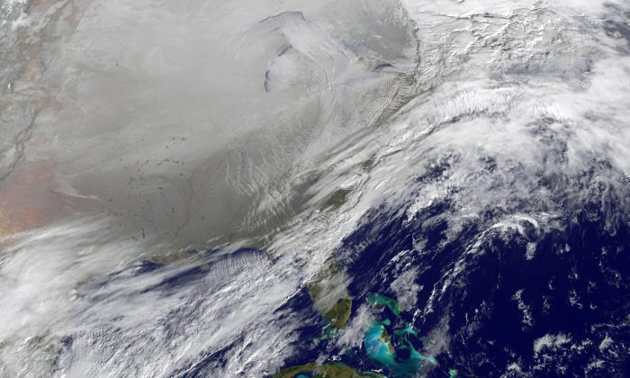 In this satellite handout image provided by National Oceanic and Atmospheric Administration (NOAA), shows the entry of a large area of low pressure, from the Polar Vortex, into the Northern U.S. January 6, 2014. (Photo by NOAA via Getty Images)