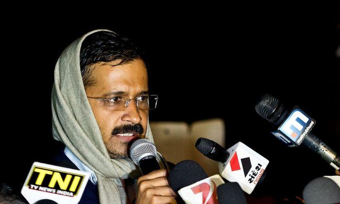 Delhi's Chief Minister Arvind Kejriwal addresses media at the venue of his sit-in protest in New Delhi on Jan. 21, 2014. (Prakash Singh/AFP/Getty Images)