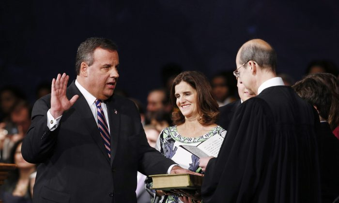 New Jersey Gov. Chris Christie (L), joined by wife Mary Pat Foster (R) is sworn in by Chief Justice of the New Jersey Supreme Court Stuart Rabner for his second term on Jan. 21, 2014 at the War Memorial in Trenton, New Jersey. (Jeff Zelevansky/Getty Images)