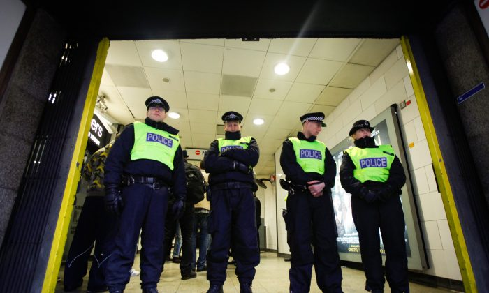 Members of the Metropolitan Police close off Holborn Tube Station on January 26, 2014 in London, England. The far-right nationalist party; Jobbik ('Movement for a Better Hungary') had planned to hold a public meeting in the Holborn area of London, but were forced to move the meeting to Hyde Park following clashes with Anti-Fascist crowds. (Photo by Dan Dennison/Getty Images)