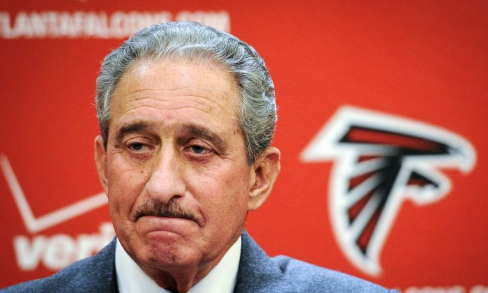 Atlanta Falcons owner Arthur Blank speaks at a news conference  in Atlanta on  Jan. 6, 2014. A planned  stadium for his new soccer team in Atlanta is drawing criticism.  (AP Photo/John Amis)