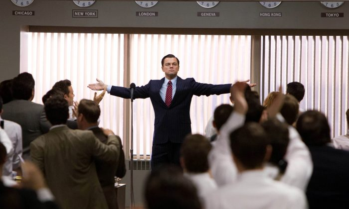 """This film image released by Paramount Pictures shows Leonardo DiCaprio as Jordan Belfort in a scene from """"The Wolf of Wall Street."""" The film was nominated for a Directors Guild award on Tuesday, Jan. 7, 2014. The winners will be announced on Jan. 25. (AP Photo/Paramount Pictures, Mary Cybulski)"""