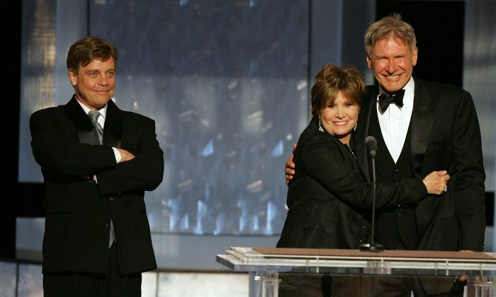 (L-R) Actors Mark Hamill, Carrie Fisher and Harrison Ford at a tribute to George Lucas in 2005 in Hollywood. The trio are slated to star in Star Wars Episode 7. (Kevin Winter/Getty Images)