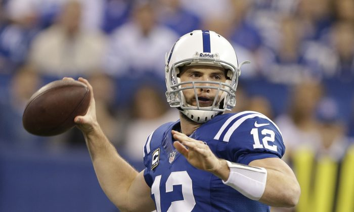Indianapolis Colts' Andrew Luck (12) throws during the first half of an NFL football game against the Jacksonville Jaguars Sunday, Dec. 29, 2013, in Indianapolis. (AP Photo/Darron Cummings)