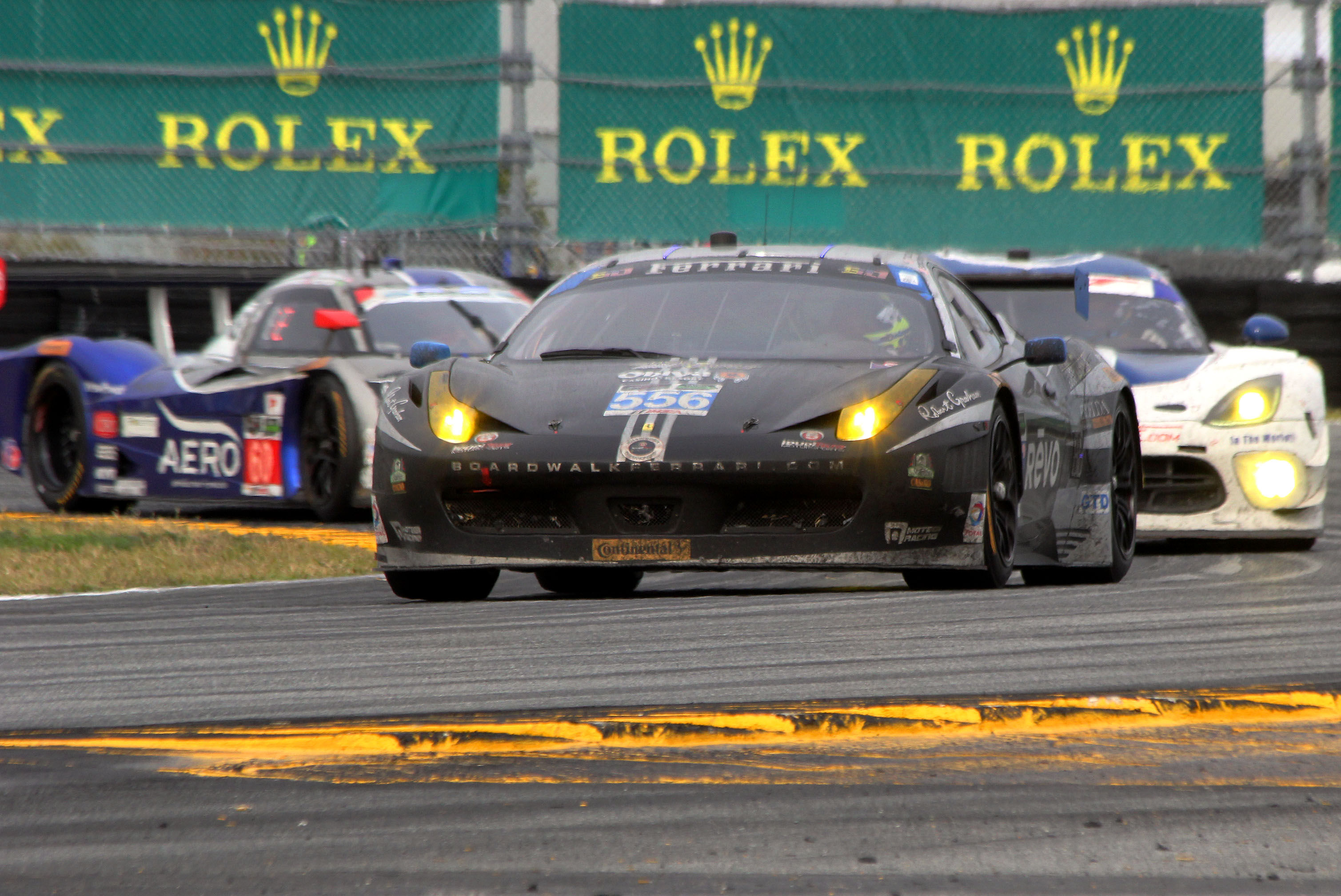 The GTD class-winning #555 Level 5 Ferrari, covered in dirt but running strong, exits the East Horseshoe half an hour from the end of the Rolex 24. (Chris Jasurek/Epoch Times)