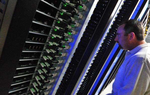 Man inspects servers (IntelFreePress)