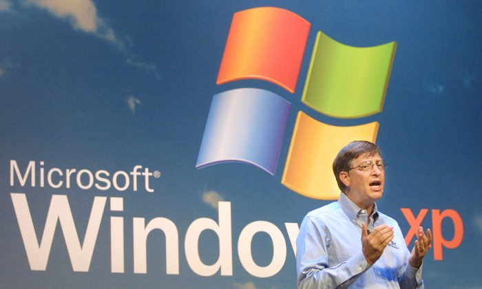 Microsoft Chairman Bill Gates speaks at the product launch of the new Windows XP operating system October 25, 2001 in New York City. The U.S. Justice Department announced November 2, 2001 that it has reached a settlement with Microsoft. The settlement will be filed in federal court in Washington, D.C. and must be approved by the presiding judge over the case. (Photo by Mario Tama/Getty Images)