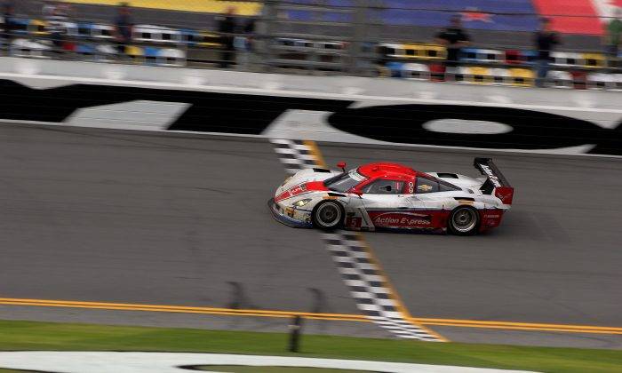 Joao Barbosa pilots the #5 Action Express Coyote-Corvette Daytona Prototype across the finish line to win the 52nd Rolex 24 at Daytona. (Chris Jasurek/Epoch Times)