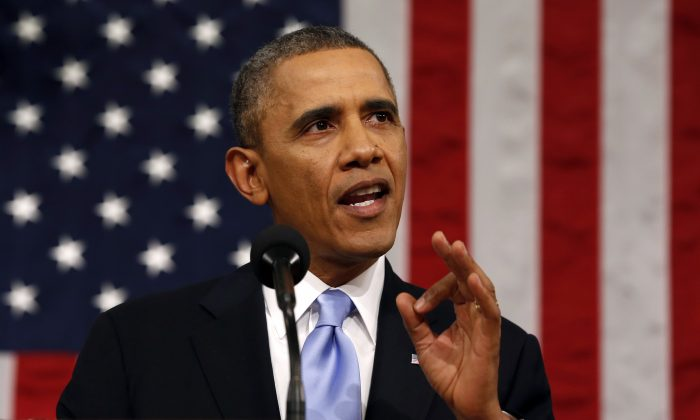 President Barack Obama delivers the State of Union address before a joint session of Cngress in the House chamber on Jan. 28, 2014. (AP Photo/Larry Downing, Pool)