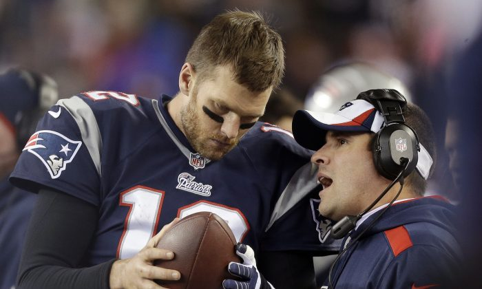 In this Nov. 3, 2013, file photo, New England Patriots offensive coordinator Josh McDaniels, right, talks to quarterback Tom Brady during the fourth quarter of an NFL football game against the Pittsburgh Steelers in Foxborough, Mass. No name stirs up quite as much angst and anger around Denver as McDaniels. The former Broncos coach, now offensive coordinator for the Patriots, left havoc in the wake of his two-year stint in Denver, and has a chance to leave another scar when the Patriots meet the Broncos in the AFC championship game on Sunday. (AP Photo/Steven Senne, File)