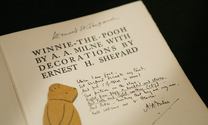 A rare Winnie-the-Pooh book showing an inscription from author A.A. Milne asking for artist E.H. Shephard to decorate his tomb. (Peter Macdiarmid/Getty Images)
