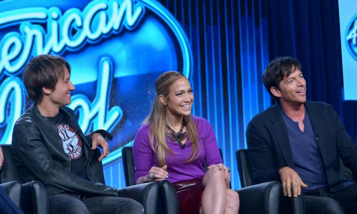 "Judges, from left, Keith Urban, Jennifer Lopez, and Harry Connick Jr. are seen during the panel of ""American Idol"" at the FOX Winter 2014 TCA, on Monday, Jan. 13, 2014, at the Langham Hotel in Pasadena, Calif. The producers of the show say the new season includes changes to freshen it, including an expanded song list for contestants. Executive producer Per Blankens said Monday, Jan. 13, 2014, that the show's song list, which has included a fair share of golden oldies, will add more current tunes that the young contestants can relate to. (Richard Shotwell/Invision/AP)"