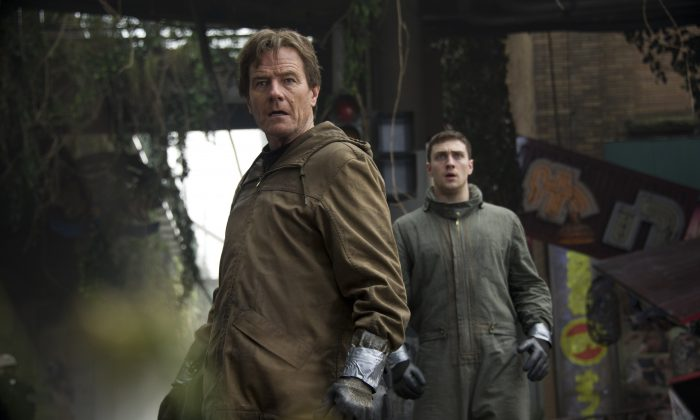 """This image released by Warner Bros. Pictures shows Bryan Cranston, left, and Aaron Taylor-Johnson in a scene from """"Godzilla."""" (AP Photo/Warner Bros. Pictures, Kimberley French)"""